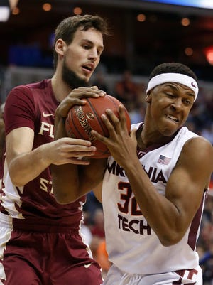 Florida State center Boris Bojanovsky, left, and Virginia Tech forward Zach LeDay (32) struggle for a rebound during the first half of an NCAA college basketball game in the Atlantic Coast Conference men's tournament Wednesday, March 9, 2016, in Washington. (AP Photo/Steve Helber)