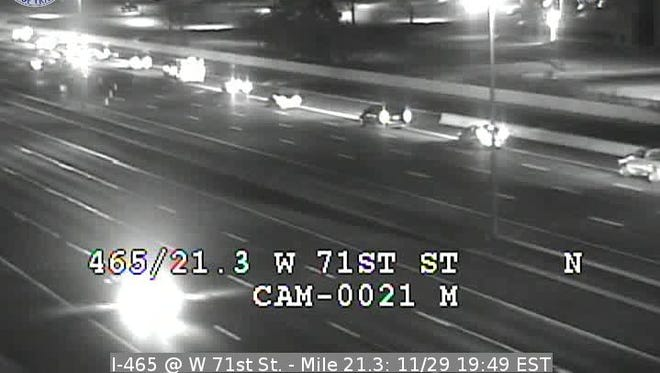 Police are investigating a fatal crash that closed northbound lanes of I-465 near West 71st Street, Tuesday, Nov. 29, 2016.