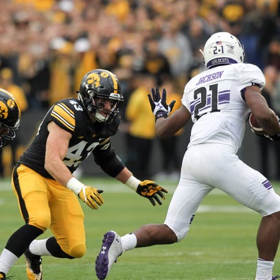 Iowa's Anthony Nelson (98) and Josey Jewell (43) had