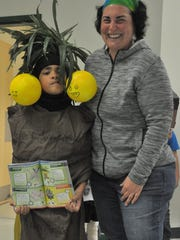 """Patrick Connor, a.k.a. Exeggutor, stands with mother and costume creator  Hollie West before the parade begins. """"I like palm trees,"""" Connor said. """"He's my favorite Pokemon."""""""