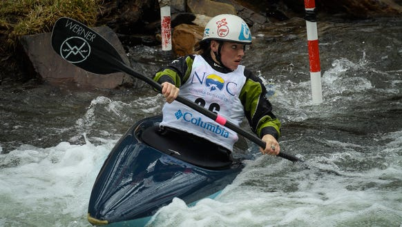Kayaking champion Adrienne Levknecht competes in a