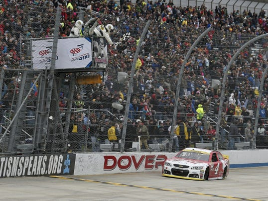 Kevin Harvick takes the checkered flag to win Sunday's AAA 400 at Dover International Speedway in Dover, Del. Harvick led for 354 laps.