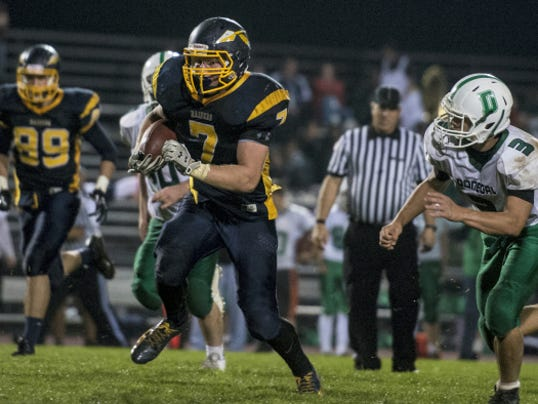 Elco junior Tyler Horst finds running room against Donegal's Austin Dimeler during the Raiders' 34-32 victory on Friday night.