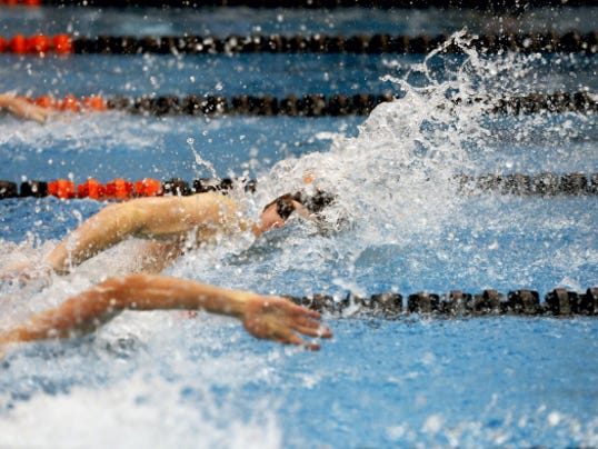 Central York's Erik Peckmann swims in the 50-yard freestyle at the YAIAA boys' swimming championships Thursday at Central York. Peckmann won the event in 22.43 seconds.