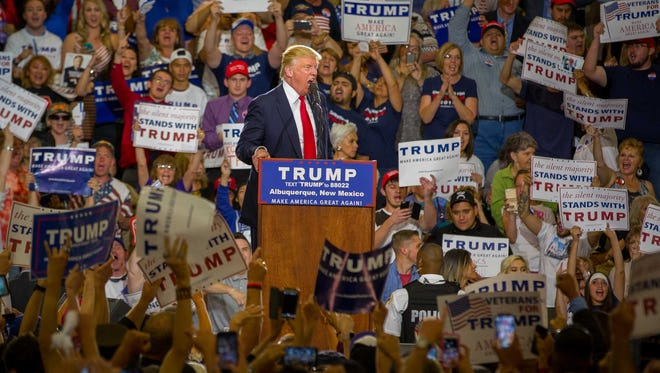 Presidential candidate Donald Trump yells at a protester during a rally at the Albuquerque Convention Center, May 24, 2016.