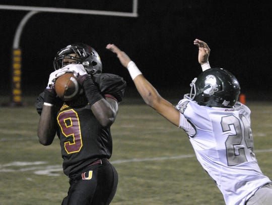 Tulare Union's Emoryie Edwards catches a long pass