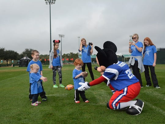 Joseph Ryan and his family play football with Mickey