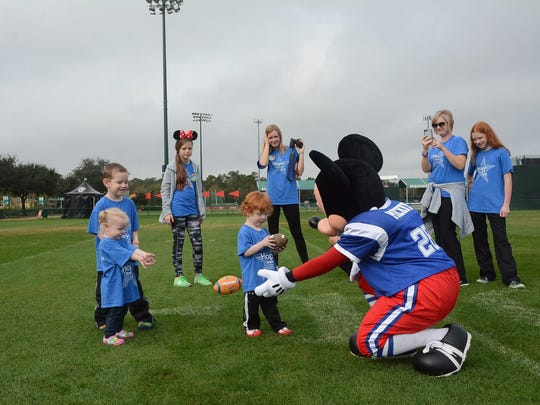 Joseph Ryan and his family play football with Mickey