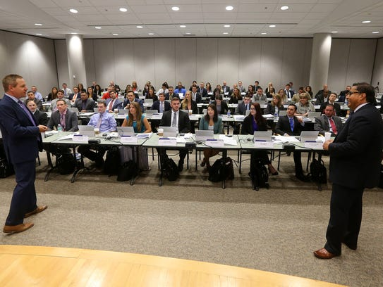 A large sales class for new employees at Paychex receive