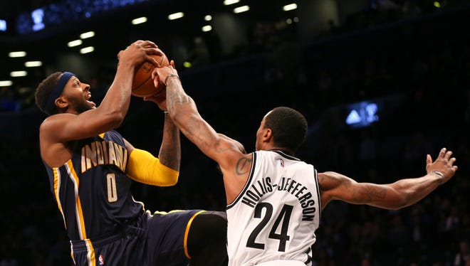 Brooklyn Nets guard Rondae Hollis-Jefferson (24) keeps Indiana Pacers forward C.J. Miles (0) from a shot during the second quarter at Barclays Center.
