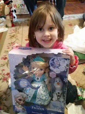 Helena White opens a present on Christmas Day, just days before an accident that left her fighting for her life.