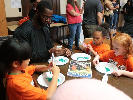 Cincinnati Bengals defensive end Michael Johnson participates in activity at the Sarah Heinz House, Saturday, Oct. 21, 2017, in Pittsburgh. He came along with Cincinnati Bengals defensive end Carlos Dunlap as he continues an anti-bullying campaign this season, stopping in AFC North cities and Jacksonville, Fla.