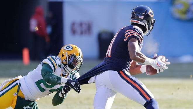 Green Bay Packers cornerback Quinten Rollins (24) tries to tackle wide receiver Cameron Meredith (81) by the shirt against the Chicago Bears at Soldier Field Sunday, December 18, 2016.