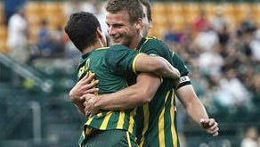 Mike Garzi, left, who set up Colin Rolfe, right, for the lone goal on Tuesday night celebrate after the Rhinos went ahead 1-0 in the 27th minute against D.C. United.