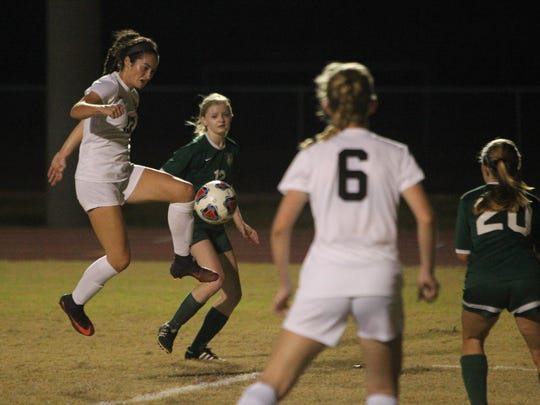 Leon sophomore Liney Brantley cleans up a long throw-in off a flip by Madison Rumenik for the Lions' first goal in a 3-0 win over Lincoln on Thursday night for the District 2-4A championship.