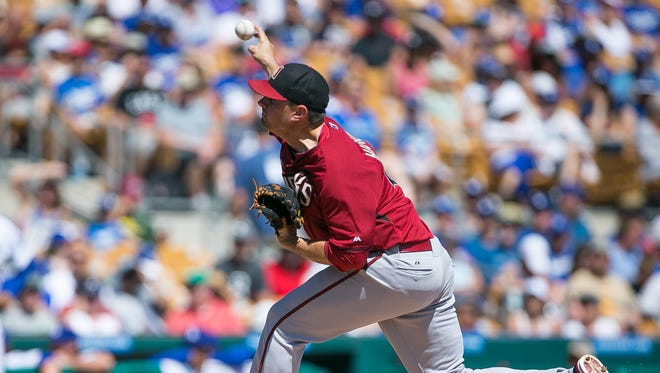 Arizona Diamondbacks pitcher Daniel Hudson throws during their spring training game against the Los Angeles Dodgers at Camelback Ranch in Glendale on Monday, March 23, 2015.