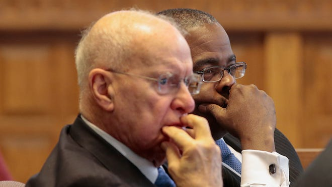 Cincinnati Park Board executive director Willie Carden, right, and Cincinnati Park Board of Commissioners chairman Otto M. Budig Jr., left, listen to Park Board superintendent Steve Schuckman during a presentation to City Council's budget and finance committee, Monday, March 28, 2016, at Cincinnati City Hall.