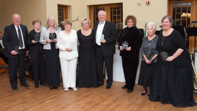 From left, Ron Daly, Lucy Diebolt, Kate Lowry, Bonnie Miller, LACASA president and CEO Bobette Schrandt, David Morse, Judge Carol Sue Reader, Jackie Rogers and Maria Stuart pose after awards were given to the eight recipients flanking Bobette Schrandt at the anniverary celebration of the domestic violence shelter.