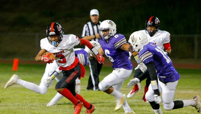 Seaside's De'Antae Choates rushes the ball during the game against Soledad.