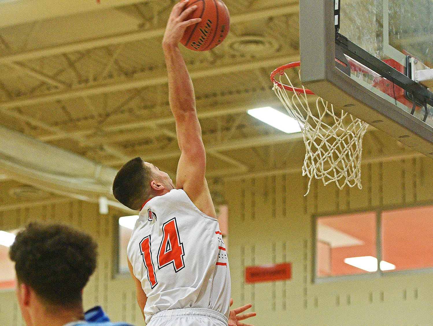 Washington's Jack Talley (14) dunks the ball during a game against Rapid City Stevens Friday, Feb. 10, 2017, at Washington High School in Sioux Falls.