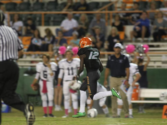 FAMU DRS cornerback Marshall Walker Jr. runs up the sideline after an interception during a 28-22 over Maclay on Friday night at Bragg Memorial Stadium.