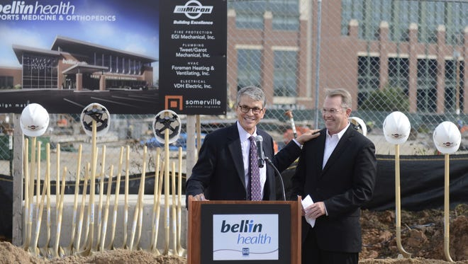 Bellin Health President/CEO George Kerwin, left, introduces Dr. Patrick McKenzie during the Bellin Health Sports Medicine & Orthopedics ground break Thursday in the Green Bay Packers' Titletown District. Oct. 6, 2016.