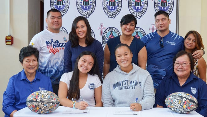 "Lavona-Rae T. Aromin and Hanna I. Rojas-Rhodes of the Academy of Our Lady of Guam received scholarships to play rugby for Mount St. Mary's University. Seated, from left: Sister Mary Angela Perez, Academy of Our Lady of Guam president; Lavona-Rae Aromin; Hanna Rojas-Rhodes; Mary A.T. Meeks, Academy principal. Standing, from left:"" Ray Aromin and Stephanie Aromin; Jina Rojas; and Anthony Ada, Jr. and Janice Ada, Academy coaches."