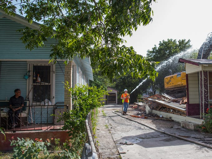 A man sits on his front porch on Noakes Street in the
