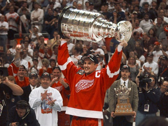Red Wings captain Steve Yzerman holds the Stanley Cup after Detroit's second straight Cup win, this time over the Washington Capitals on June 16, 1998.