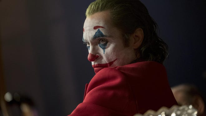 """This image released by Warner Bros. Pictures shows Joaquin Phoenix in a scene from """"Joker."""" On Monday, Jan. 13, Phoenix was nominated for an Oscar for best actor for his role in the film. (Niko Tavernise/Warner Bros. Pictures via AP)"""