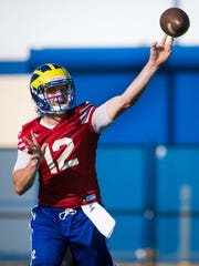 University of Delaware quarterback Pat Kehoe makes a pass at the first day of practice for the Blue Hens.
