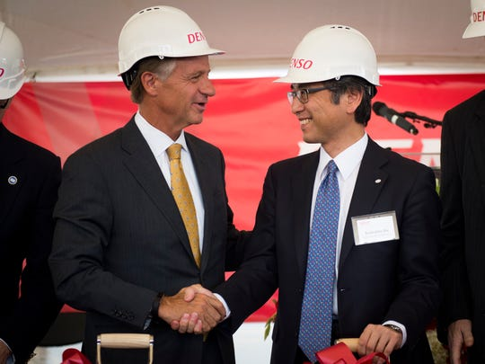 Gov. Bill Haslam shakes the hand of Ken Ito, chairman of DENSO's North American Board of Directors and chief executive officer of DENSO International America, Inc., after the company Denso announces expansion plans in Maryville on Friday, Oct. 6, 2017.