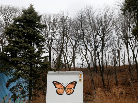 A painted butterfly on the back of a storage container