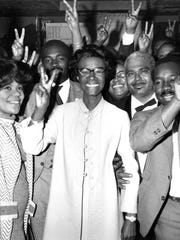 Shirley Chisholm is surrounded by campaign workers flashing the victory sign, shortly after she won election to Congress from New York City's Bedford-Stuyvesant district, on Nov. 6, 1968.