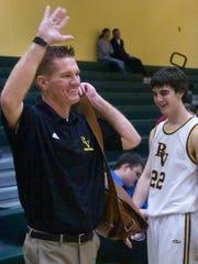 Bishop Verot coach Matt Herting waves to fans after