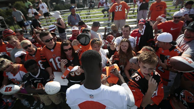Fans reach out to Cincinnati Bengals wide receiver A.J. Green (18) for autographs after a joint practice between the Cincinnati Bengals and the New York Giants at the Bengals practice facility in downtown Cincinnati.