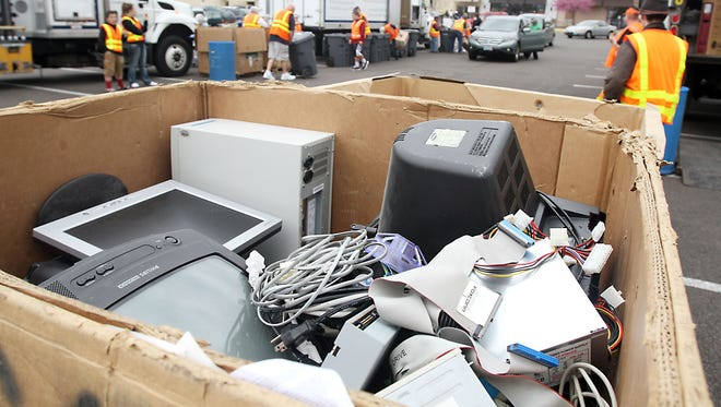 Electronics devices sit waiting to be recycled.