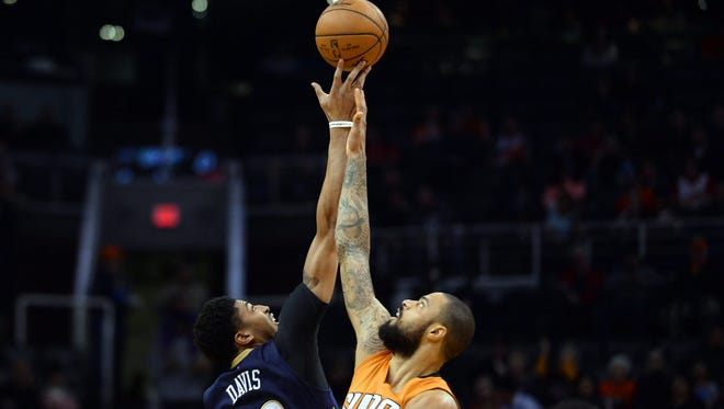 New Orleans Pelicans forward Anthony Davis (23) and Phoenix Suns center Tyson Chandler (4) go up for the opening tip during the first half at Talking Stick Resort Arena.