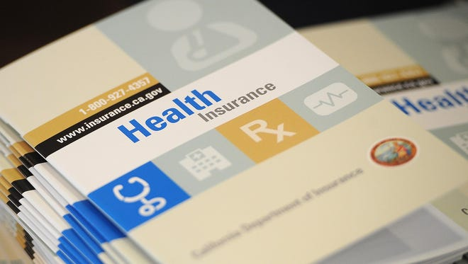 Booklets show health insurance options.