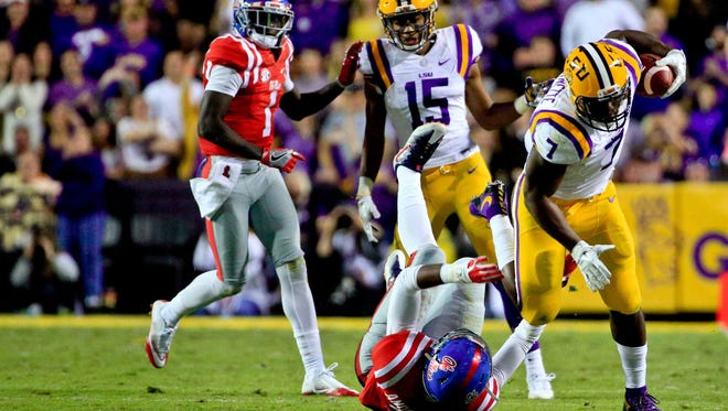 LSU running back Leonard Fournette runs through Ole Miss safety Deontay Anderson during the game Saturday in Baton Rouge.