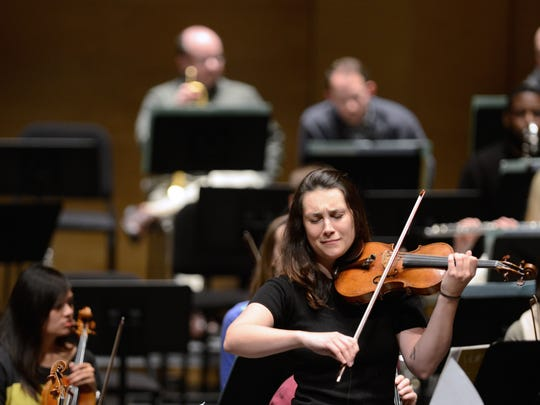 Sarah Larsen rehearses a solo with the Green Bay Symphony