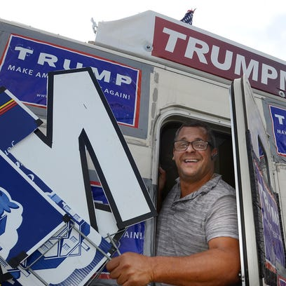 "Rob Costis steps out of his ""Trump Mobile"" RV on Aug."