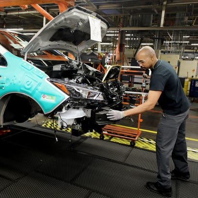 An employee at Nissan's Smyrna plant works to assemble