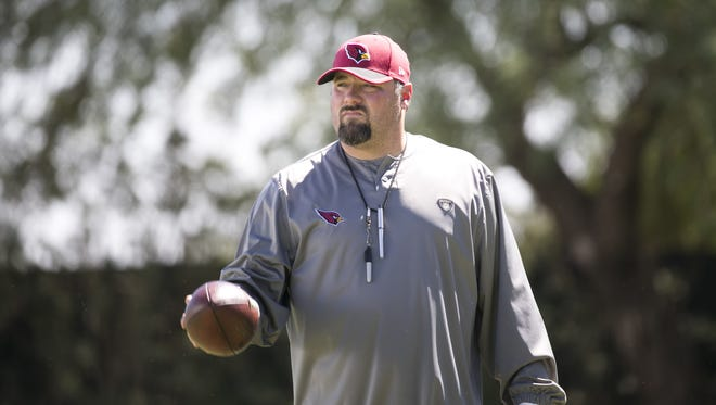 Cardinals defensive coordinator James Bettcher looks on during a Cardinals practice at the Cardinals training facility.