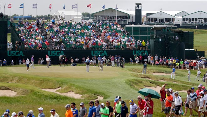 Large crowds followed golfer Jordan Spieth and others on No. 9 during the first day of practice for the  2017 U.S. Open  Championship at Erin Hills on Monday.