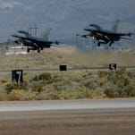 Two F-16 Fighting Falcon's take off the runway at Holloman Air Force Base Oct. 13. The F-16's are part of the 311th and 314th Squadrons who are responsible for training skilled and efficient F-16 fighter pilots for the Combat Air Force.