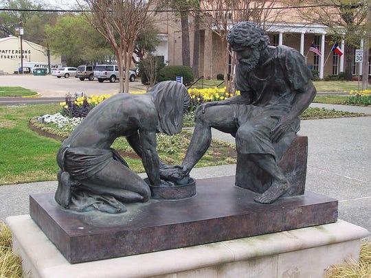 Jesus washing Peter's feet. Sculpture beside the Prayer Tower, Pittsburg, Texas.