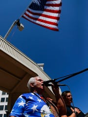 Local entertainer Bob Mondy sings the national anthem