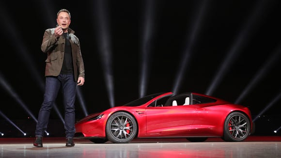 Tesla founder Elon Musk presents the new Roadster electric sports vehicle on Nov. 16, 2017, at Tesla's Los Angeles design center. Tesla says the Roadster will accelerate from 0 to 60 mph in less than two seconds. Tesla says the new Roadster will cost $200,000 and will be released in three years.