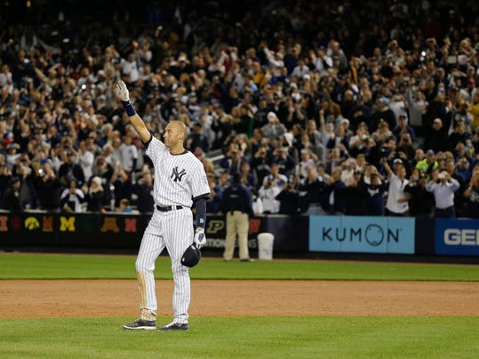 New York Yankees shortstop Derek Jeter waves to fans as he walks around the infield after driving in the winning run against the Baltimore Orioles in the ninth inning of a baseball game, Thursday, Sept. 25, 2014, in New York. The game, which the Yankees won 6-5, was Jeter's last home game of his career. (AP Photo/Julie Jacobson)
